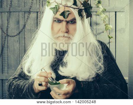 Zeus Making Potion