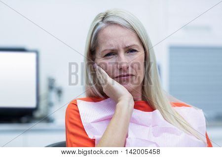 Portrait of unhappy woman having a toothache