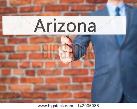 Arizona - Business Man Showing Sign