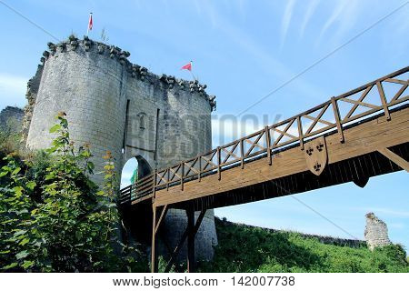 view of the suspension bridge and the entrance  to the fort castle lavardin