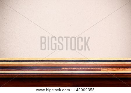Empty wooden table with plywood wall background. For display or montage your products.