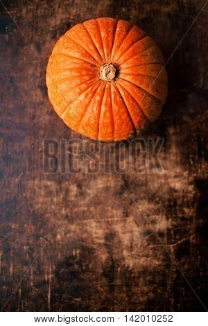 Autumn pumpkins over wooden table top view image. Autumn background  poster