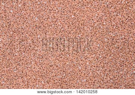 Orange linoleum dotted texture or background closeup