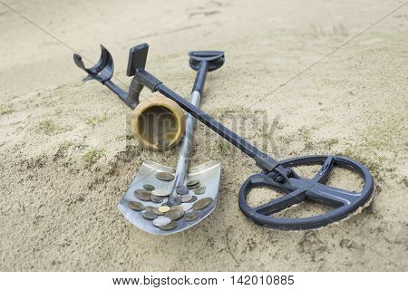 Search for treasure using a metal detector and shovel.