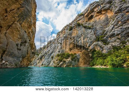 The rocky slopes of canyon Verdon descend into azure water of the river. Mercantour National Park, Provence