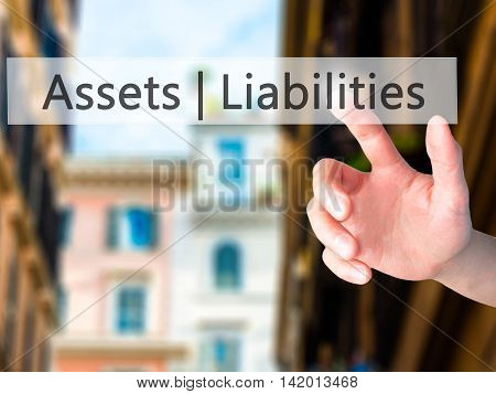 Assets Liabilities - Hand Pressing A Button On Blurred Background Concept On Visual Screen.
