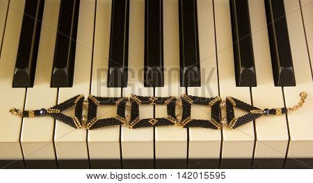 Close up of beautiful bijouterie on background of piano