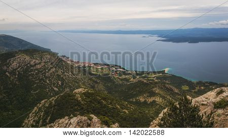 Village Bol and Zlatni Rat Beach on Brac Island viewed from Mountain Vidova Gora, Croatia