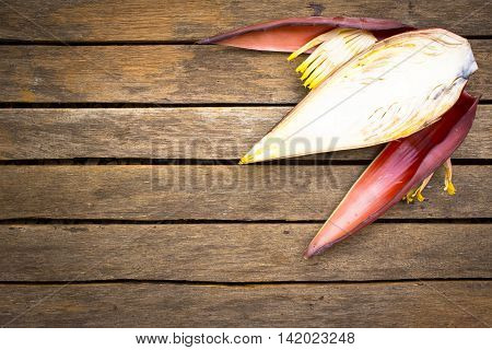 Banana blossom on wooden background.Raw food or background food.1