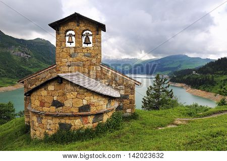 French Alps: сhurch on the mountain lake shore