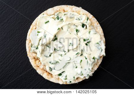 Puffed Rice Cake With Chive And Herb Spread Isolated On Dark From Above.