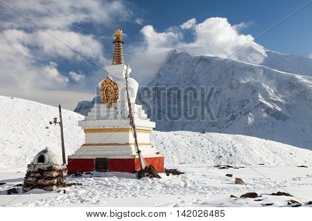 Panoramic view of Annapurna 3 III Ganggapurna and Khangsar Kang with buddist stupa from Ice Lake way to Thorung La pass round Annapurna circuit trekking trail Nepal