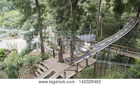 Tricycle On Wooden Bridge In Forest