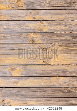 old planked wooden background with peeling paint residues