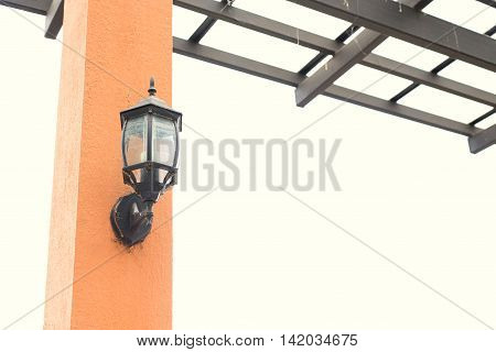 A classic lamp on the concrete post.