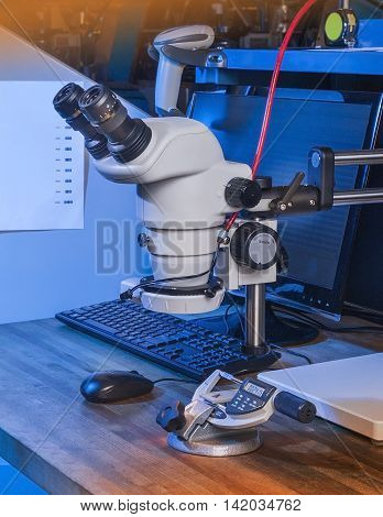 Microscope and micrometer used to check quality in machine shop