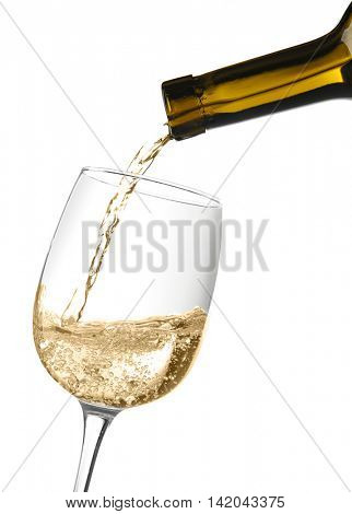 White wine pouring into wine glass, isolated on white