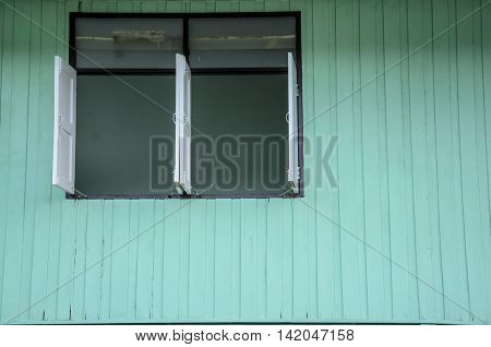 Windows with green wooden wall in Thailand
