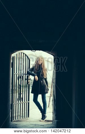 Young Girl Near Forged Door