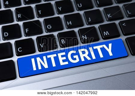 INTEGRITY a message on keyboard business man work