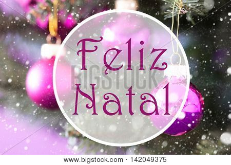 Blurry Christmas Tree With Blurry Rose Quartz Balls. Close Up Or Macro View. Christmas Card For Seasons Greetings. Snowflakes For Winter Atmosphere. Portuguese Text Feliz Natal Means Merry Christmas