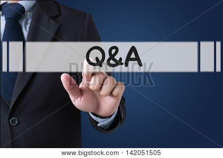 Q&A - Question and Answer Businessman hands touching on virtual screen and blurred city background