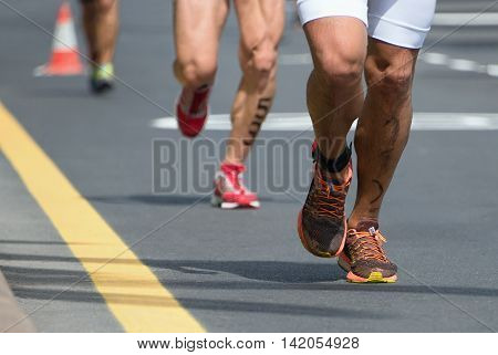 Marathon competition during an ironman the numbers on the leg