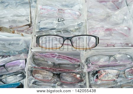 Eyeglasses in a market stall at the Albert Cuyp market in Amsterdam.