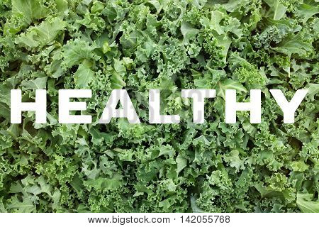 Healthy Text Over Shredded Kale Leaves Background