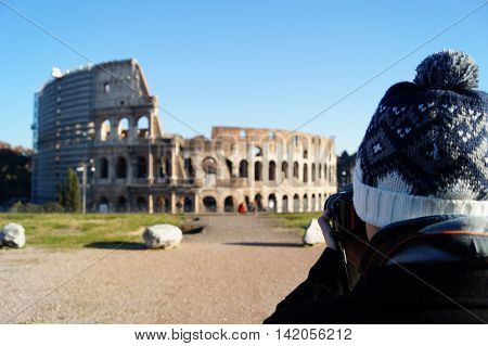 photographer taking a picture of the coliseum