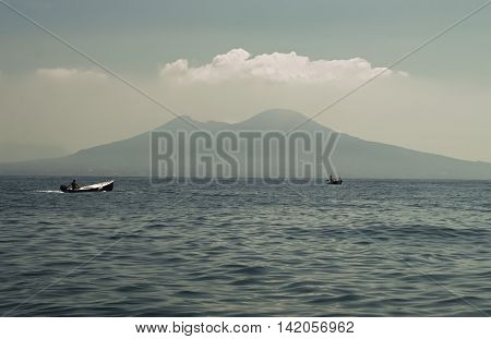 A sea view of Mount Vesuvius with boat