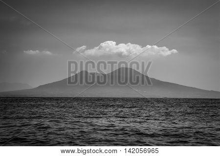 Retro vintage black and white sea view of Mount Vesuvius