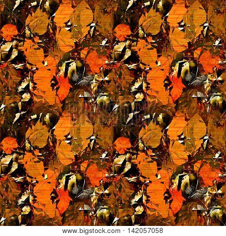 Seamless blurred pattern with autumn leaves on a gold and black metal background. Red and orange stylized autumn leaves on a cracked rusty background