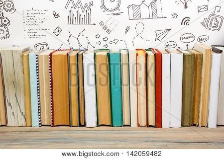 Colorful composition with vintage old hardback books, diary on wooden deck table and formula math background. Books stacking. Back to school. Copy Space. Education background