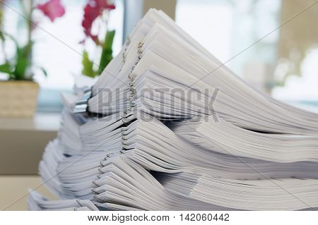 Stack Of White Document  On Office Background