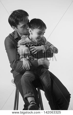 Black and white photo of happy and joyful father with six years old son father's day