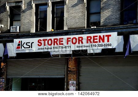 New York City - November 3 2015: Store for Rent sign on a former sneaker shop on Broadway in Hamilton Heights