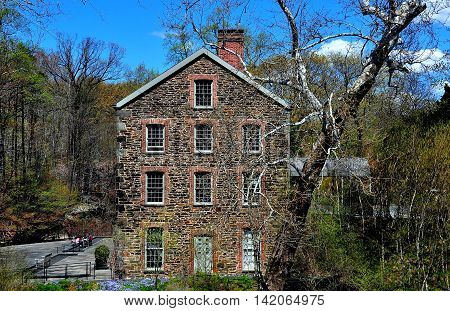 Bronx New York - April 29 2015: The 1840 Old Stone Mill at the New York Botanical Garden *