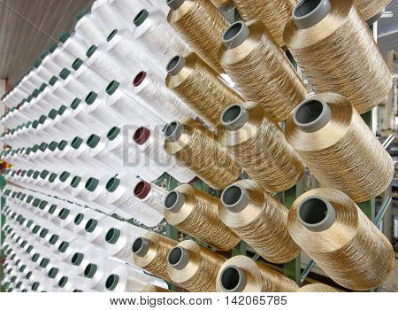 Thread yarn factory gold and white coil