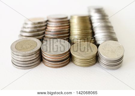 Baht Thai Coins Stacked Isolated On White Background.