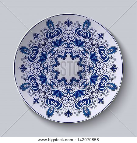 Blue decorative ornament. Pattern is applied on a ceramic plate. Vector illustration.