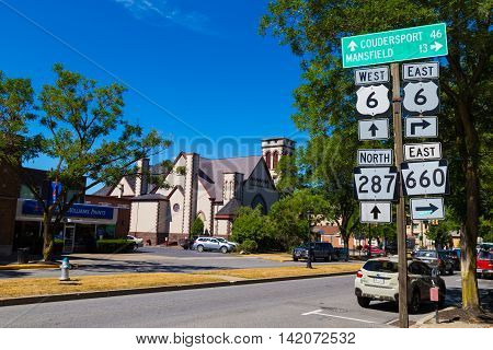 Wellsboro PA - July 26 2016: Directional Route Signs on the Main Street of Wellsboro in Tioga County Pennsylvania