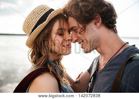 Close up portrait of happy young couple in love embracing each other on beach