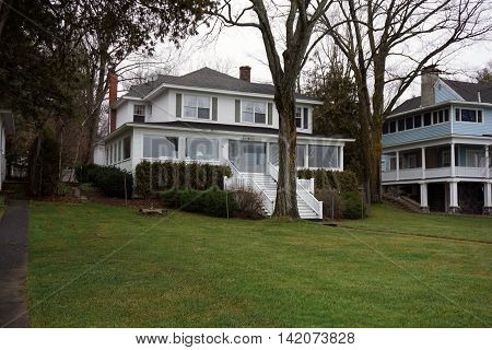 WEQUETONSING, MICHIGAN / UNITED STATES - DECEMBER 22, 2015: An elegant white home, christened Third Base, on Beach Drive in Wequetonsing.