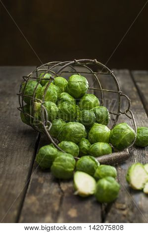 freshly picked organic Brussels sprouts on a rustic table