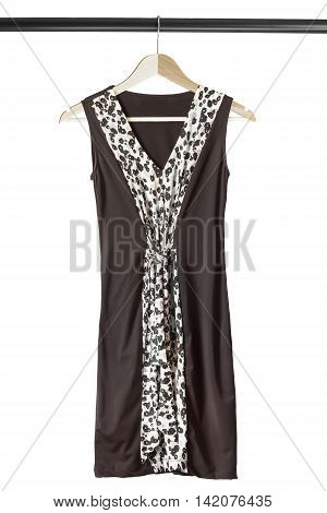 Brown silk dress on wooden clothes rack isolated over white