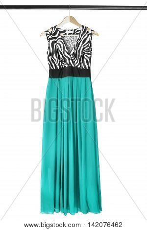 Chiffon cyan gown on wooden clothes rack isolated over white