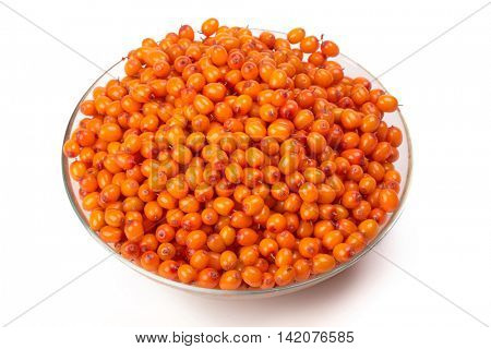 Plate with mature sea-buckthorn berries on a white background.