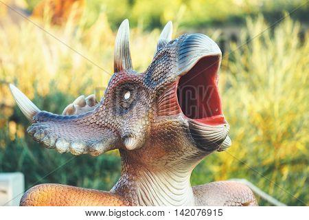 NOVI SAD SERBIA - AUGUST 5 2016: Small dinosaur trash bin toy from themed entertainment Dino Park in Novi Sad.