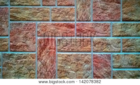 Wall lined with colored square tiles in shades of pink.